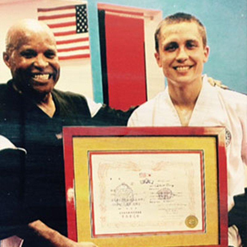 Grand Master Robert Maloney presenting Master Zang with his 7th Degree Black Belt