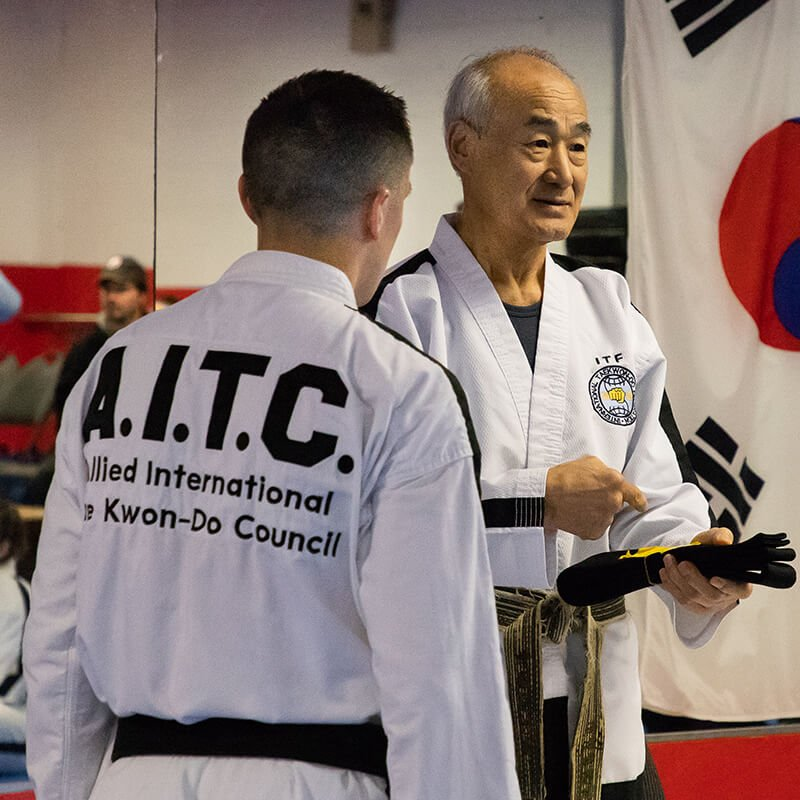 Grand Master Park Jong Soo presenting Grand Master Zang with his 8th Degree Black Belt